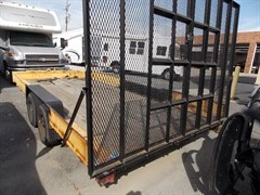 A 1999 Superior Flat Bed Trailer