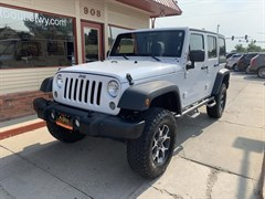 A 2014 Jeep Wrangler Unlimited SPORT